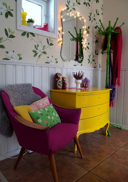 Purple chair, fun pillows, yellow dresser, green coat rack, great tile floors - just needs different wallpaper? @Abbey Adique-Alarcon Landrum @Rachel Landrum
