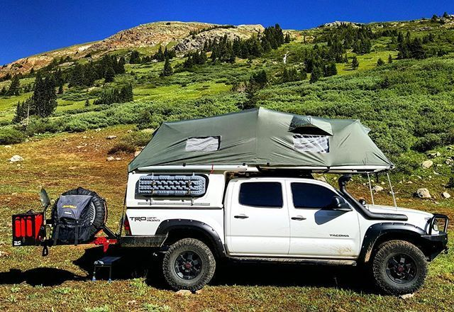 Featured Vehicle: Jon Burtt's Toyota Tacoma . SPECS 2015 Toyota Tacoma TRD Off-Road IMG_20160809_143656 Exterior - Flippac Camper by FRP - Rechelon Aesthetics Projector Headlghts - Front Runner SlimLine Roof Rack Custom length with Rigid Industries Duallys mounted over Rear doors - Overland Bound #653 badges - TRED 4×4 Ramps mounted to side of Flippac - Trasharoo by Slee Off-Road - CBI ditch lights with Rigid Industries Duallys - Hi-lift jack - Fisker Axe - Shovel Amour - Pelfreybilt Offroad…