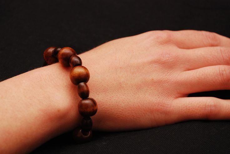 Bracciale elastico perle tonde e ovali in legno