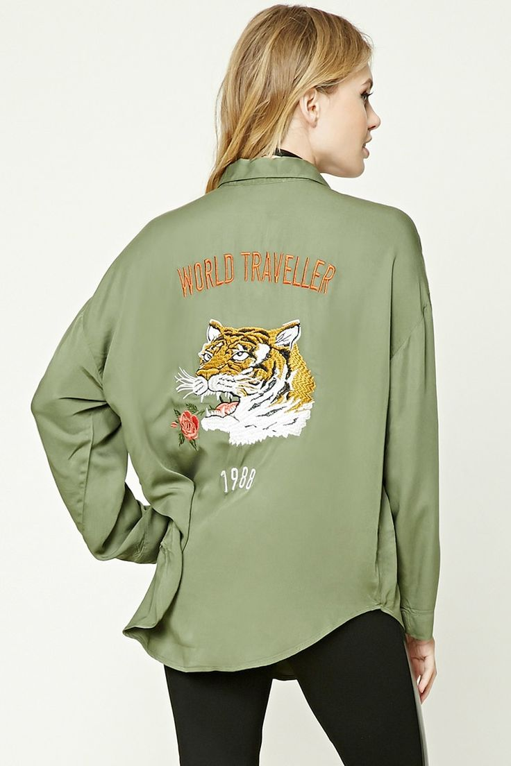"""Forever 21 Contemporary - A woven shirt featuring an embroidered """"World Traveler 1988"""", a tiger and rose embroidered patches on the back, a buttoned front, a basic collar, a curved hem, long sleeves, and a billowy silhouette."""