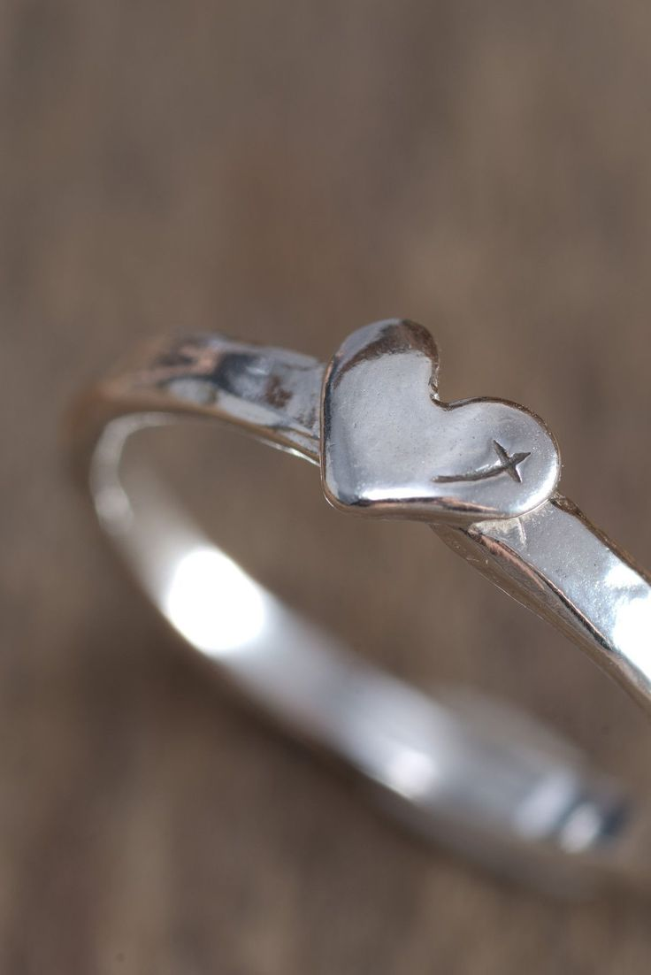 Narrowsterling silver band with raised petiteheart and tiny etched cross reflection. Available in sizes: 5, 6, 7, 8, 9, 10...