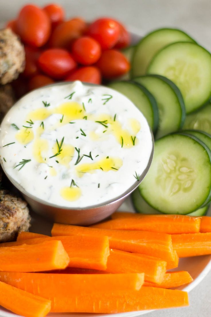 How to Make Tzatziki Sauce 2 Ways! This healthy and easy tzatziki sauce will become a staple in your house. Only 8 ingredients and it can be made using Greek yogurt or dairy free so it\'s paleo, vegan, gluten free, and Whole30 approved. Great for meal prep too! - Eat the Gains #dairyfree #glutenfree #paleo #whole30 #vegan