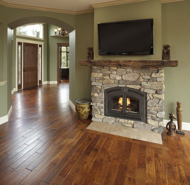 Country Residence traditional living room - wall color, fireplace with aged wood mantle.  Love the flow from entry to living room.
