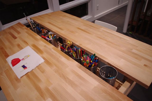 I LOVE this table for the kids in the Bonus Room!  Especially useful is the wide space for activity/multiple kids, and the center for easy-to-reach pencils/crayons/markers...