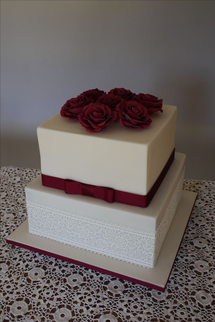 Wedding cake with burgundy hand made sugarpaste roses
