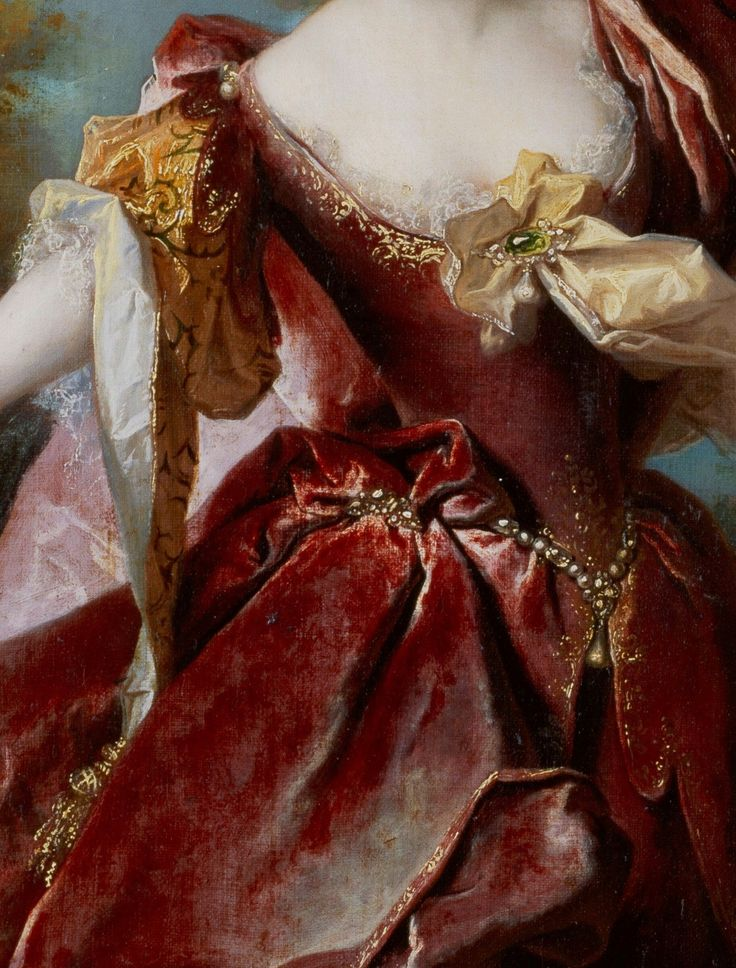 Detail of red velvet gown (bodice and petticoat) with gold and pearl embellishments, fanciful gold silk sleeves lined with white silk, delicate lace edge of chemise showing at square neckline, and a large gold silk bow pinned to the middle front of the bodice with a sizeable emerald set in gold broach with one drop pearl. Portrait of the actress Marie-Anne de Chateauneuf, known as Mlle Duclos (1664-1747) in the role of Ariane, 1712, Nicolas de Largillierre (1656 - 1746).
