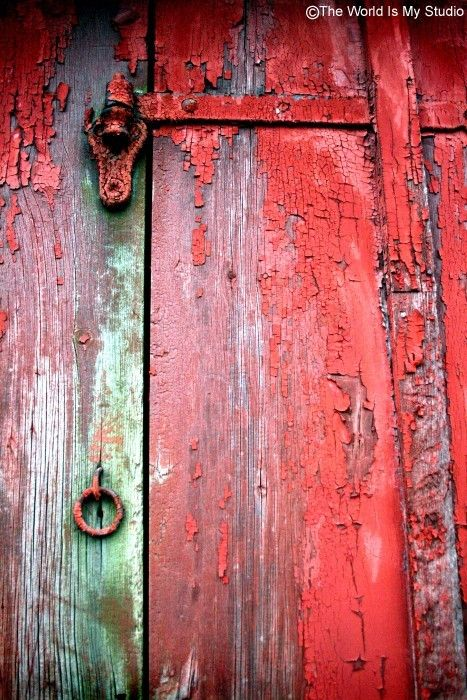 .old weathered red door