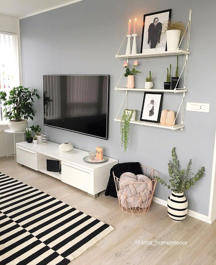 Tv mounted with bookshelves on wall