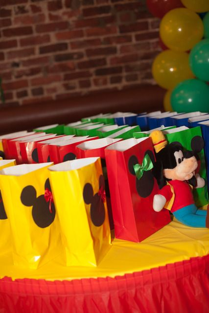 Super cute party favor bags - what should I put in them?    Mickeys for the boys and Minnie's for the girls!