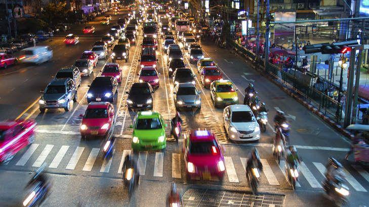 Traffic colours the streets of Bangkok at night.