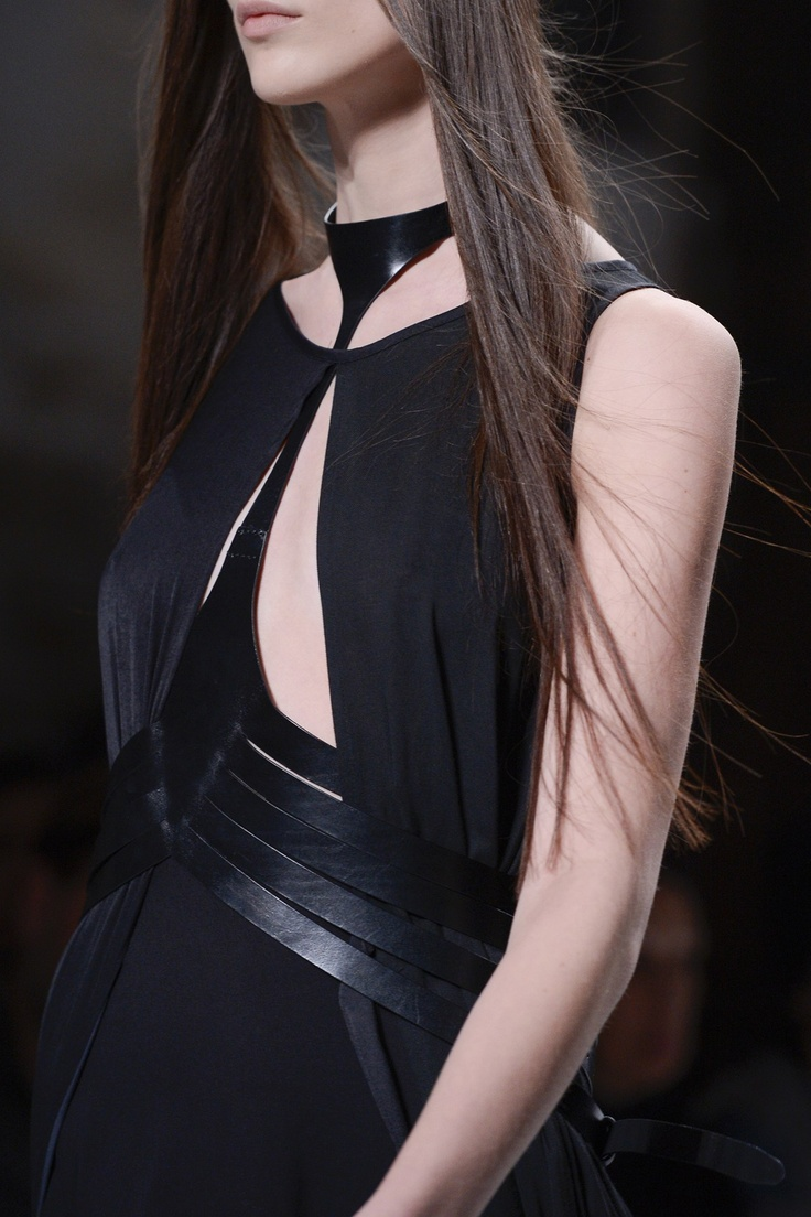 Asymmetric leather harness layered over a free-flowing black dress; edgy feminine fashion details // Ann Demeulemeester SS13