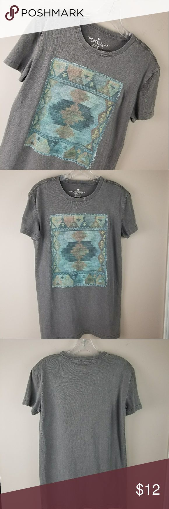 NWOT. AMERICAN EAGLE Aztec Printed T-shirt! NWOT. This gray printed T-shirt offers a distressed modern look! Pair with skinny jeans and booties and you're ready for a casual night out! Size XS. Looks generously cut for size. Please see Measurement & fabric content photos above. American Eagle Outfitters Tops Tees - Short Sleeve