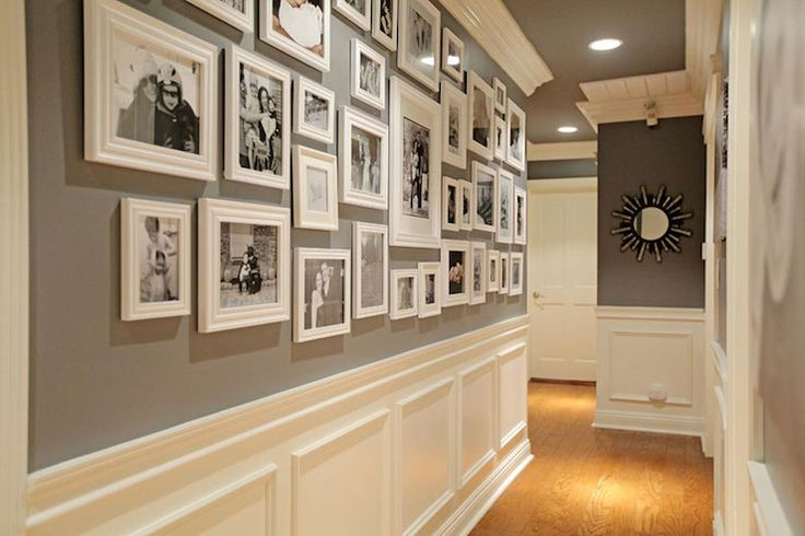 source: Jenn Feldman Designs Fabulous hallway features black and white photo wall on dark gray walls over white wainscoting. Foyer hallway with dark gray ceiling dotted with pot lighting.