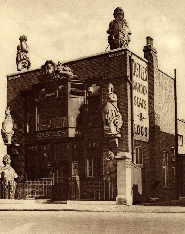 Old fighting ship figureheads at Henry Castle & Son, Ship Breakers in the Grosvenor Road, London. Photo: William Whiffin