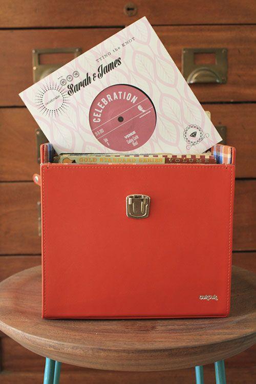 """Bespoke 7"""" vinyl invitations."""