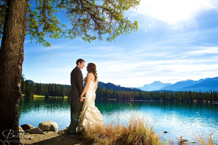 Bride and Groom photos by the lake in Jasper, Alberta.