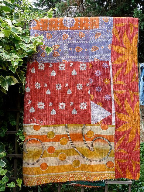 This quilt is gorgeous! one side is a multicoloured patchwork of pieces that all work really well together (not always the case with kantha quilts!) and the other side is a deep bottle green with distinctive diamond shapes embroidered on it in white and red thread. There are some loose ends of cotton sticking out of the ends, as is often the case with these quilts, but two minutes on a sewing machine would hem it nicely. It would make a great throw for a bed,chair or sofa, could be used…