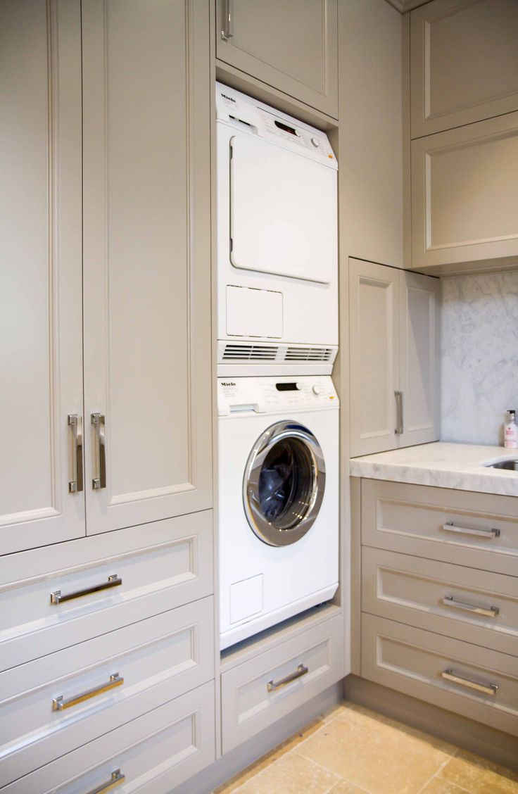 This large, family laundry has a laundry shoot and lots of storage for completely practical use. www.thekitchendesigncentre.com.au  @thekitchen_designcentre