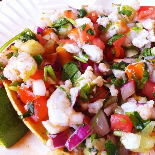 Shrimp Ceviche Tostada....a Hancock family favorite, we add some Clamato to the ceviche and just eat it with a spoon. :)
