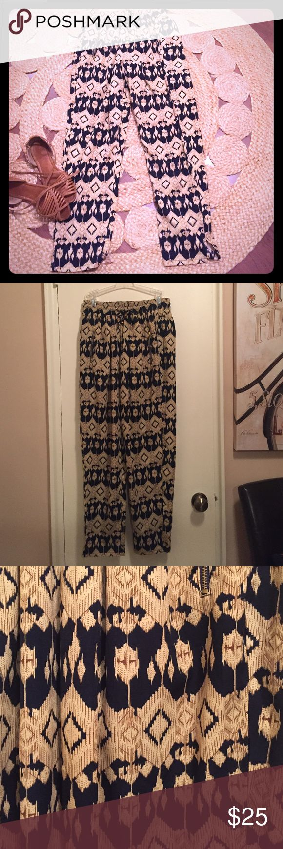 Tribal Print Pants Beautiful Black and Tan tribal print pant. Elastic waistline with drawstring. Zippered side slit pockets. Tapers towards the ankle. Worn once. Like new. Pants