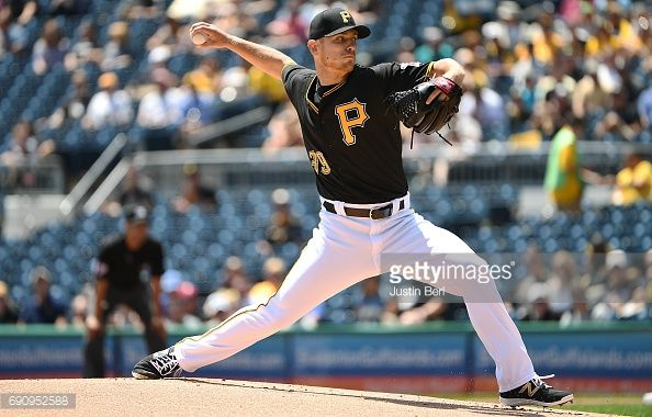 News Photo : Chad Kuhl of the Pittsburgh Pirates delivers a...