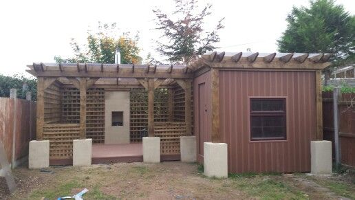 After - Garden shed & patio with outdoor fireplace