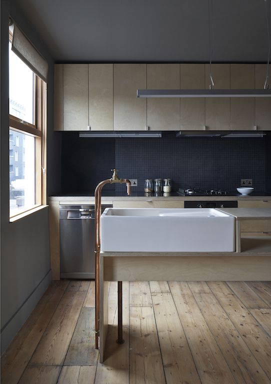 Ironmongers' Quarters - Flat 1 | Jonathan Tuckey Design, Hackney Road, East London - A large butler sink sits on a bespoke Birch plywood island, finished with copper pipes and taps.