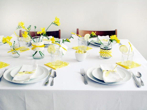The yellow flowers could go in baby food jars on a GREEN linen for a green & gold graduation party.