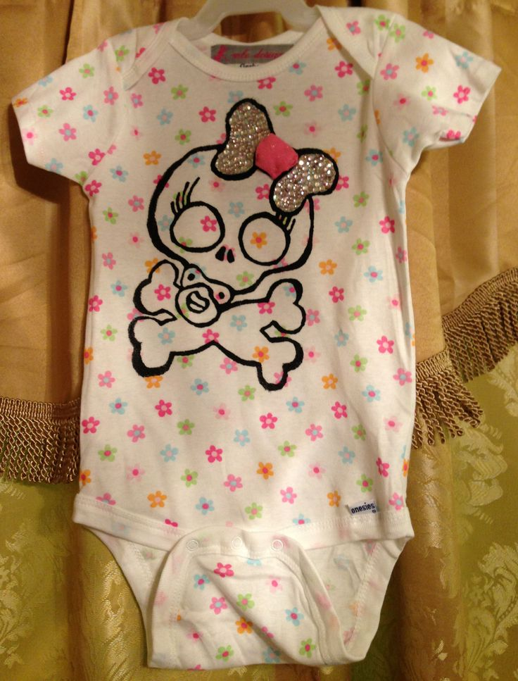 Baby Girl Skull on a Flower Onesie with a Rhinestone Bow: https://www.etsy.com/listing/151778419/baby-girl-skull-on-a-flower-onesie-with?ref=shop_home_active