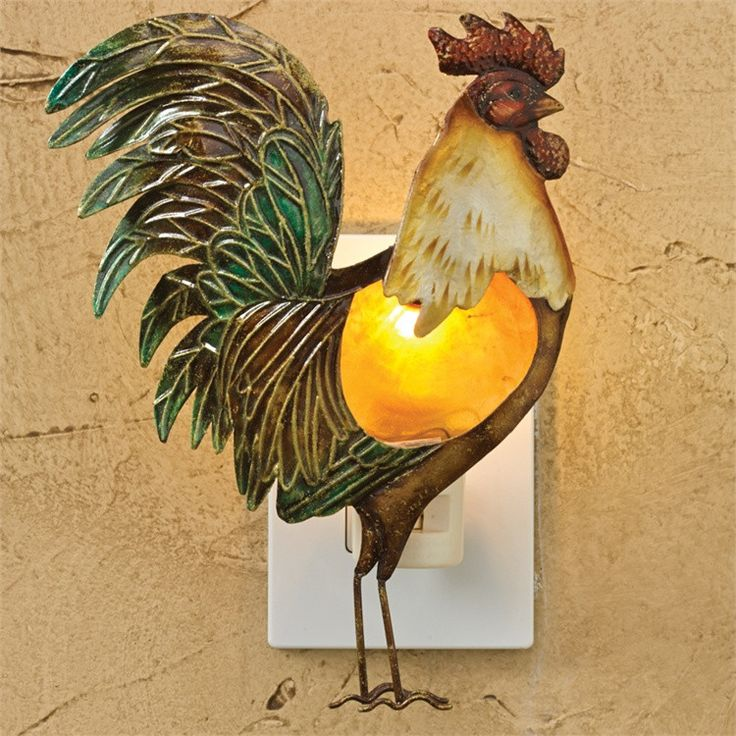 """This Rooster Night Light features hand painted embossed metal. Bulb included. Ready for use. Dimensions: 8""""H x 6""""W x 1.5""""D Material: Iron"""