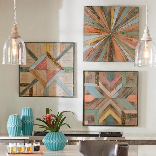 Natural wood, crafted into stunning, but practical pieces, has become a coveted element for the modern home. (Think wood plank flooring or handcrafted coffee tables.) Our Box Wood  Metal Wall D puts this modern, yet rustic material on the wall as art, in large format. A richly weathered patchwork, it matches long, colorful, triangular pieces - and those left with a natural finish - into a dramatic starburst, that  from the center outward. Small metal accents and heavily  pieces of wood are…