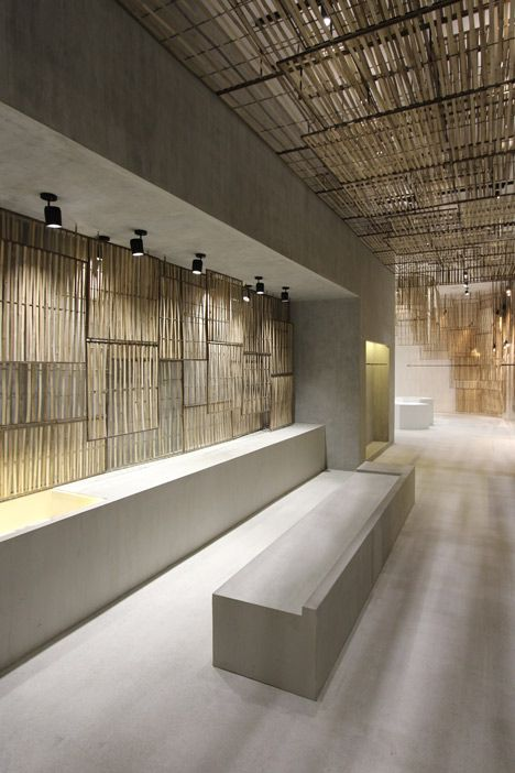 While some screens are suspended from the ceiling to form a hanging installation that resembles a chandelier, others cover the walls in the corners of the store, spanning all the way down to the floor.