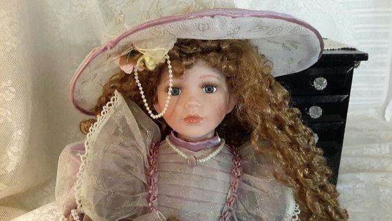 Victorian Porcelain Doll with Long Red Curls by OurVintageNest