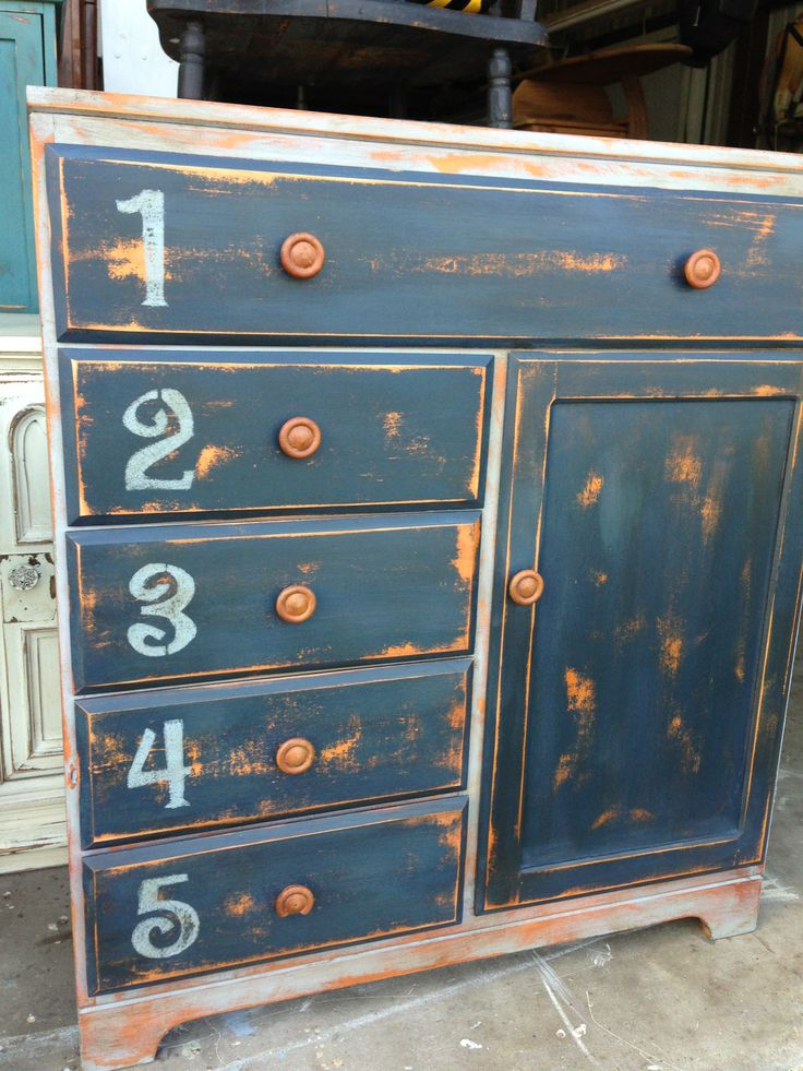 A child's armoire painted and distressed in Artissimo an I added numbers in Shutter Grey to give it character.