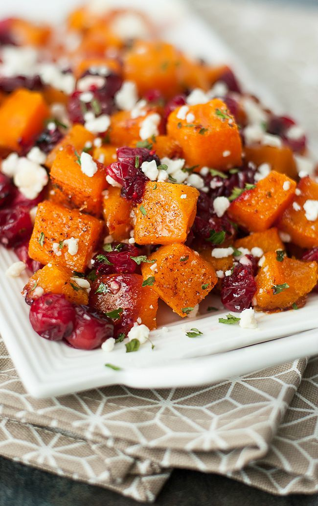 Honey Roasted Butternut Squash with Fresh Cranberries and Feta. Could sub in goat cheese or use craisins.