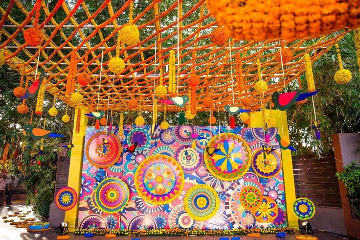Mela Themed Colorful Mehndi Sangeet Wedding Photography Ahmedabad