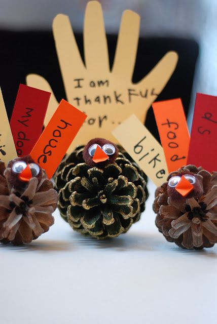 Thanksgiving Pinecone Turkey Also Done it but had kids stick feathers in the pinecones