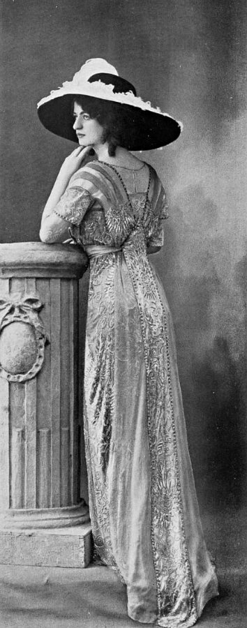 An elaborate dinner gown of 1910. Broad-brimmed hats of this kind were sometimes worn in the evening as well as during the day.