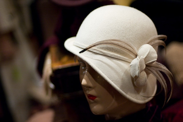 lovely asymmetrical cloche. like the use of thin feathers (picks up the lines of the trim well)
