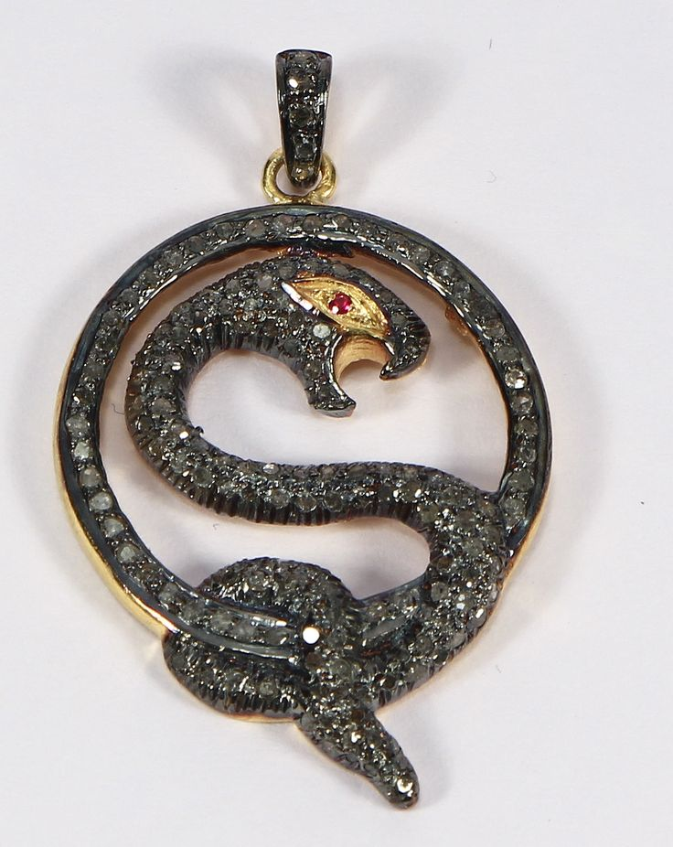 Snake Design Pendant in 925Sterling Silver and Pave Diamonds with Ruby Eye
