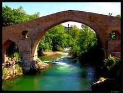 "Roman Bridge with its ""Victory jewel cross"" Cangas de Onis, Asturias, Spain."