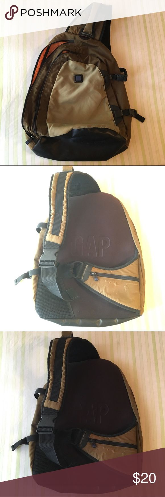 One shoulder backpack/ satchel GAP brand one-shoulder backpack/ satchel in masculine colors. Tan, brown/green with hunter orange interior. Zippers work and there is no compromising damage, but there are signs of wear on hardware & bottom, also a few pen marks inside that I have not attempted to wipe off. Will ship wiped and sanitized. Measurements and wear marks in photos. Several adjustable clasps. MAKE AN OFFER! Tags: cross body sling GAP Bags Backpacks