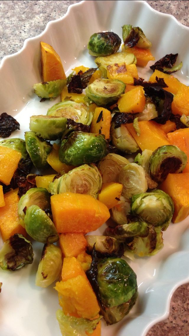 Pre-heat oven to 425. Place 1 bag cut squash and 1 bag cut Brussels sprouts on backing tray.  Drizzle with olive oil and mix with hands.  Sprinkle with sea salt.  Bake in the oven 25 minutes.