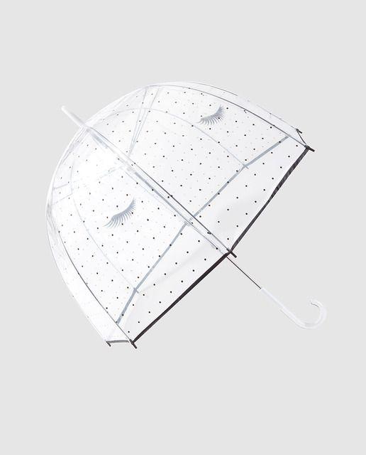Paraguas transparente con topos negros