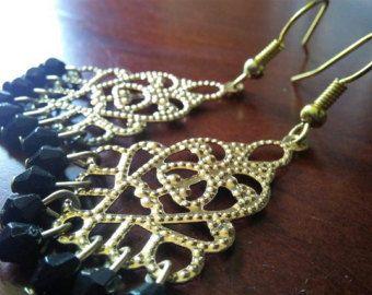 Pendientes de araña negra y oro