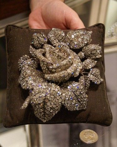 """Created by Theodore Fester in 1855, the gold-and-silver-setting rose has about 250 carats of diamonds and was created for Princess Mathilde Bonaparte, Napoleon's niece.  She owned one of Paris' most distinguished literary and artistic salons.  When she died in 1904, the piece was auctioned and eventually sold by Cartier to Mrs. Cornelius Vanderbilt III, of the railroad Vanderbilts, who wore it at the waist or bodice for portraits and other formal occasions in her role as """"Queen of Society."""""""