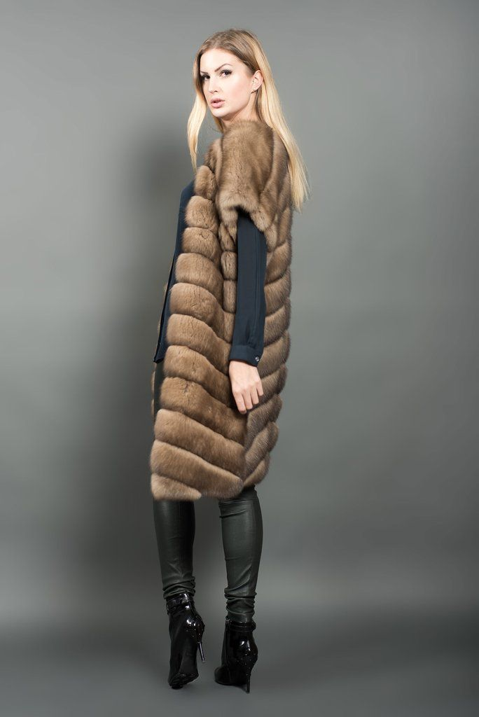 A Russian Barguzin sable fur vest. This model hasdiagonal tailoring, pockets and is reversible. Designed and produced in Italy using Russian Barguzin sable fur