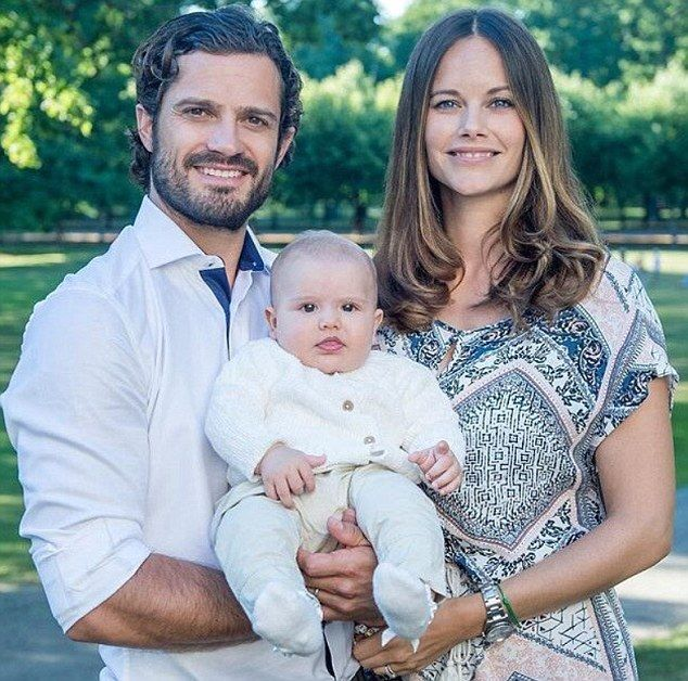 Is he pointing at the camera? A playful Crown Prince Alexander smiles at the camera as he poses with his parents Prince Carl Philip and Princess Sofia to announce the little boy's baptism on September 9th