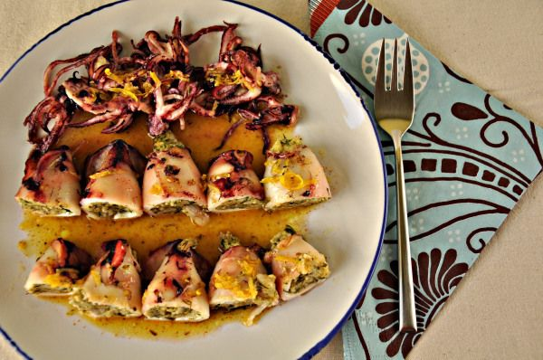 Grilled stuffed squids with herbs and olive oil-lemon sauce