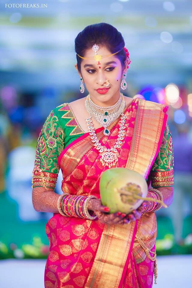 South Indian bride. Diamond Indian bridal jewelry. Jhumkis. Red silk kanchipuram sari with contrast green blouse.Braid with fresh jasmine flowers. Tamil bride. Telugu bride. Kannada bride. Hindu bride. Malayalee bride.Kerala bride.South Indian wedding.
